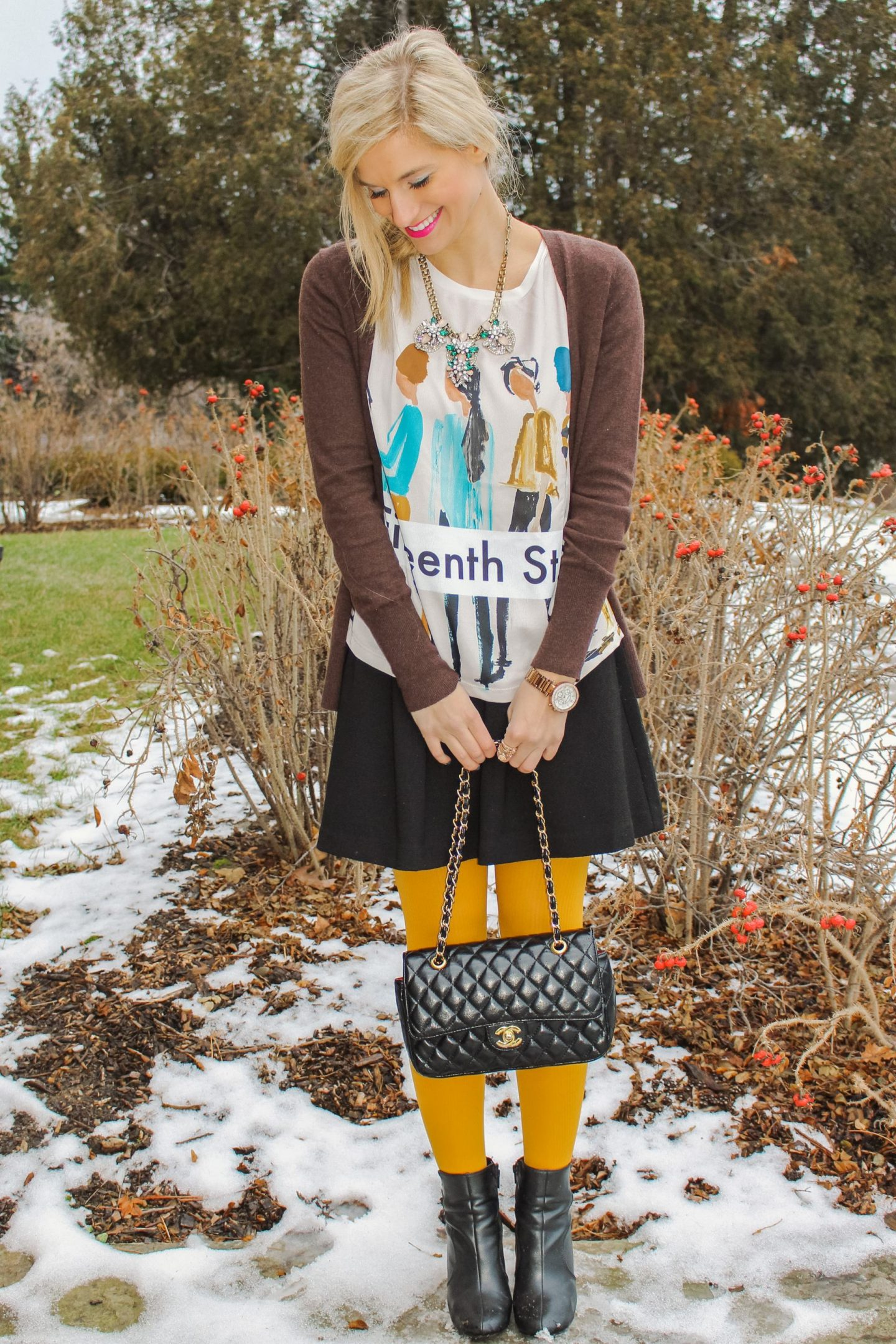 Wearing my colored tights in the winter with my everyday black skirt and Chanel purse.