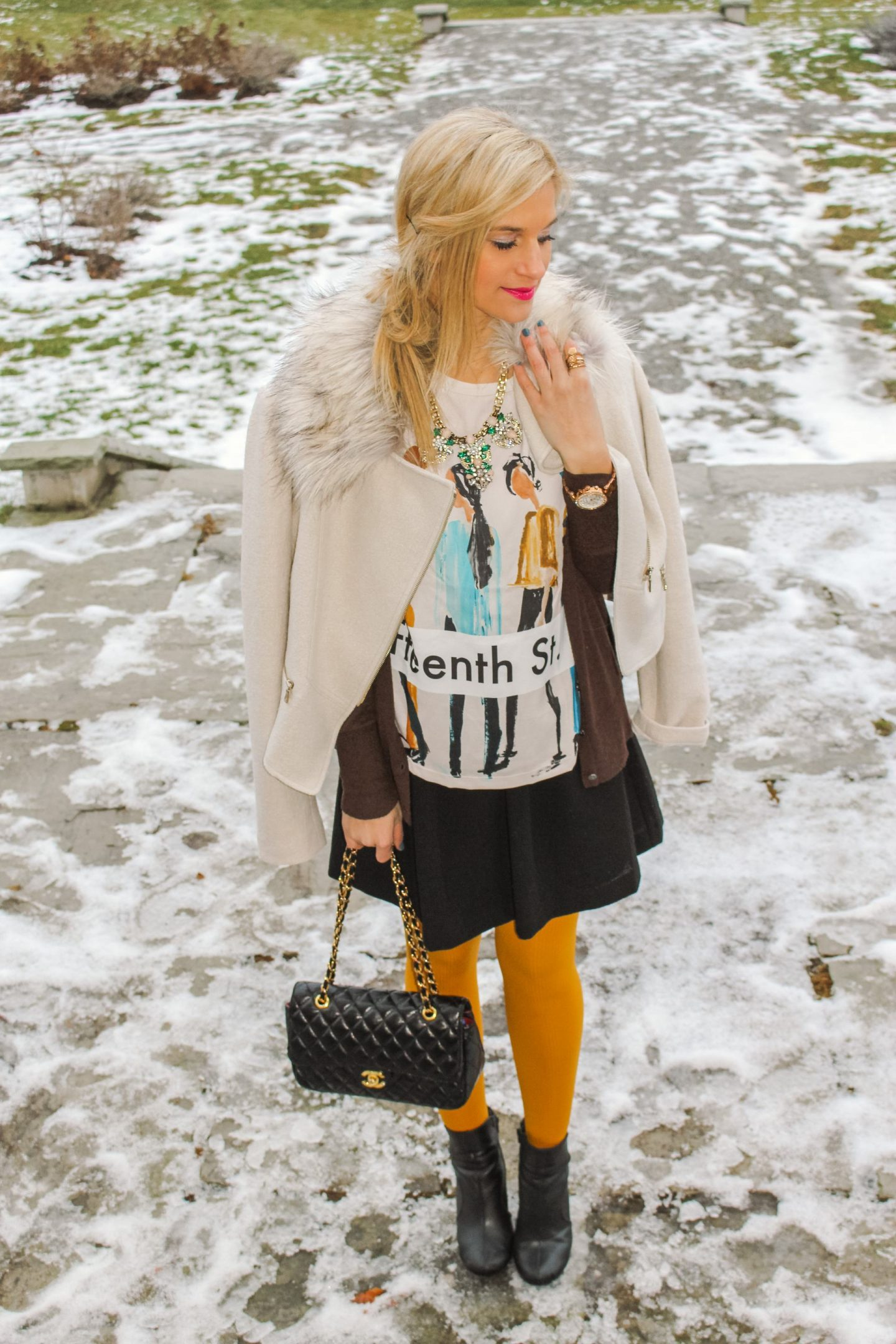 How to pull off wearing yellow tights in the winter as an adult. Black skirt with graphic top, cardigan and yellow tights.