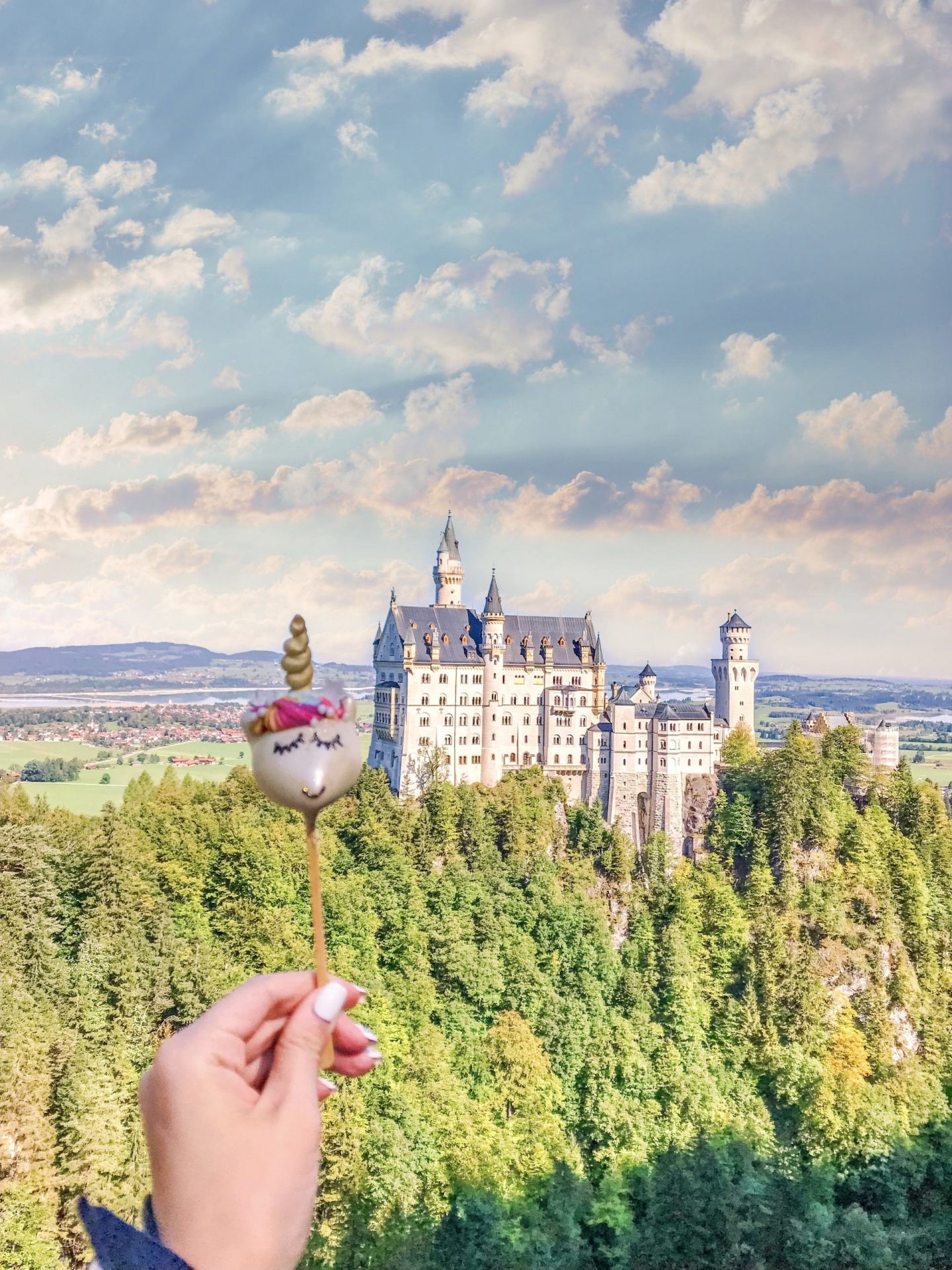 Bijuleni - Neuschwanstein Castle and unicorn cakepop. View from Mary's Bridge
