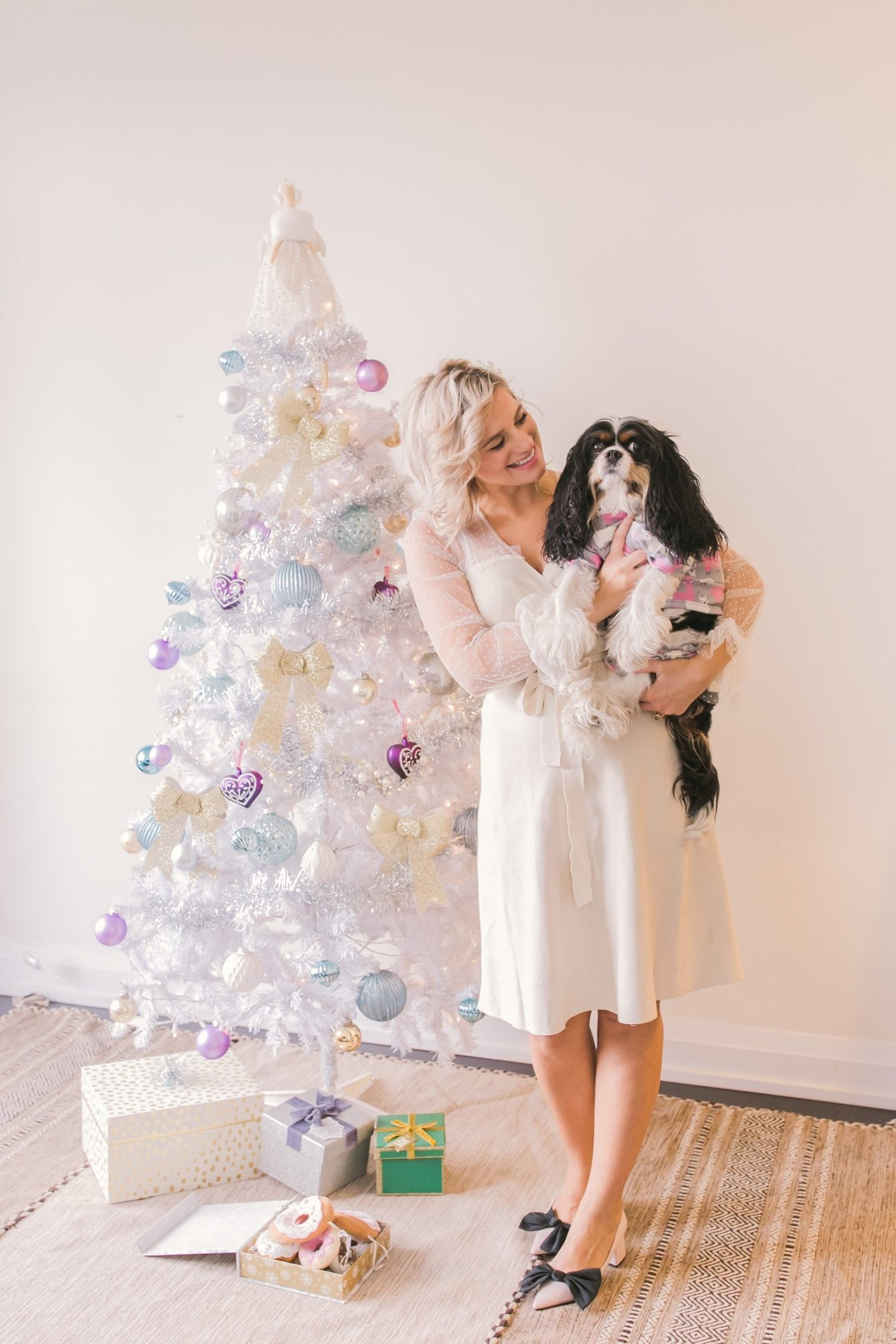 Make any space a Winter Wonderland with a white artificial Christmas tree. Cavalier King Charles Spaniel puppy.
