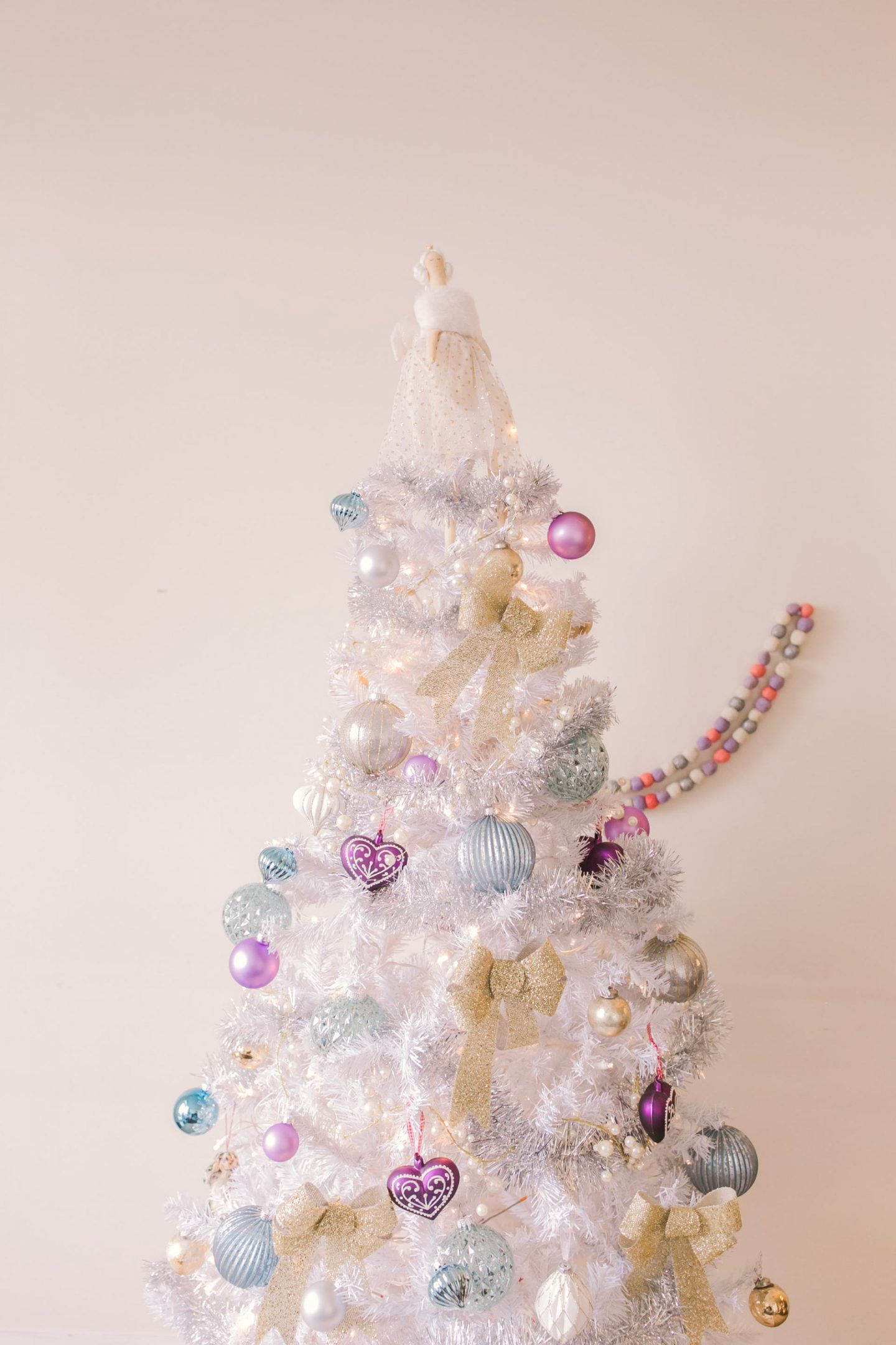 Glam Christmas tree decorated with glass ornaments,gold bows, metallic garland, and sparkle!